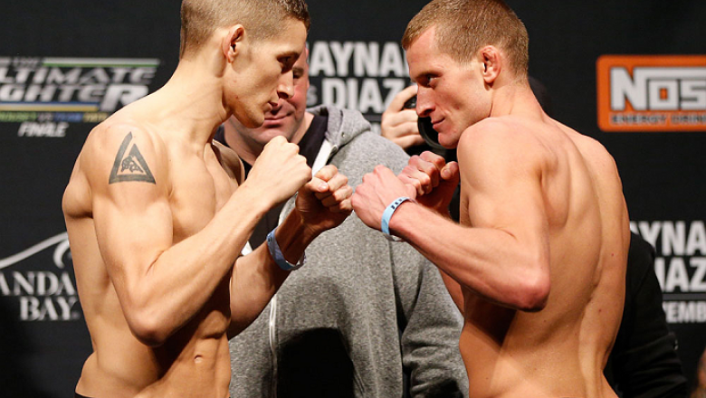 """LAS VEGAS, NV - NOVEMBER 29:  (L-R) Opponents Chris Holdsworth and David """"Davey"""" Grant face off during the weigh-in for The Ultimate Fighter season 18 live finale inside the Mandalay Bay Events Center on November 29, 2013 in Las Vegas, Nevada. (Photo by J"""