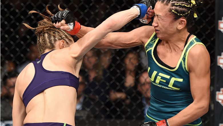 LAS VEGAS, NEVADA - DECEMBER 12: (L-R) Rose Namajunas exchanges punches with Carla Esparza in their strawweight championship fight during The Ultimate Fighter Finale event inside the Pearl concert theater at the Palms Casino Resort on December 12, 2014 in