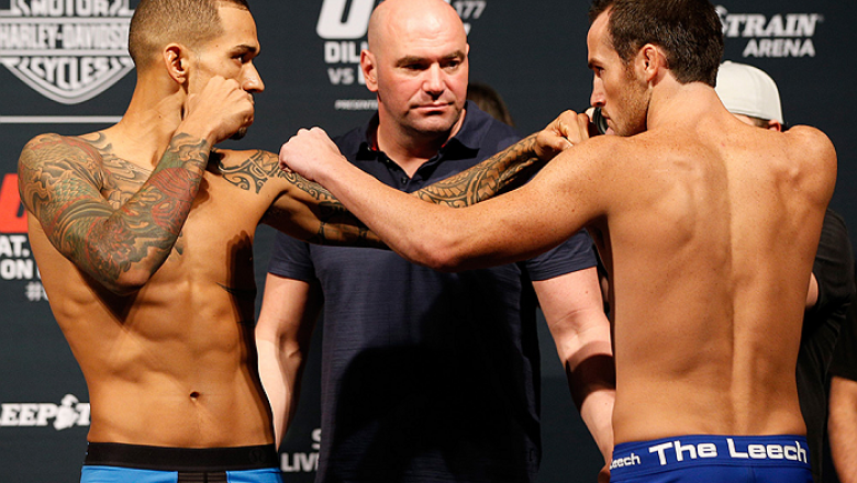 SACRAMENTO, CA - AUGUST 29:  (L-R) Opponents Yancy Medeiros and Damon Jackson face off during the UFC 177 weigh-in at Sleep Train Arena on August 29, 2014 in Sacramento, California.  (Photo by Josh Hedges/Zuffa LLC/Zuffa LLC via Getty Images)