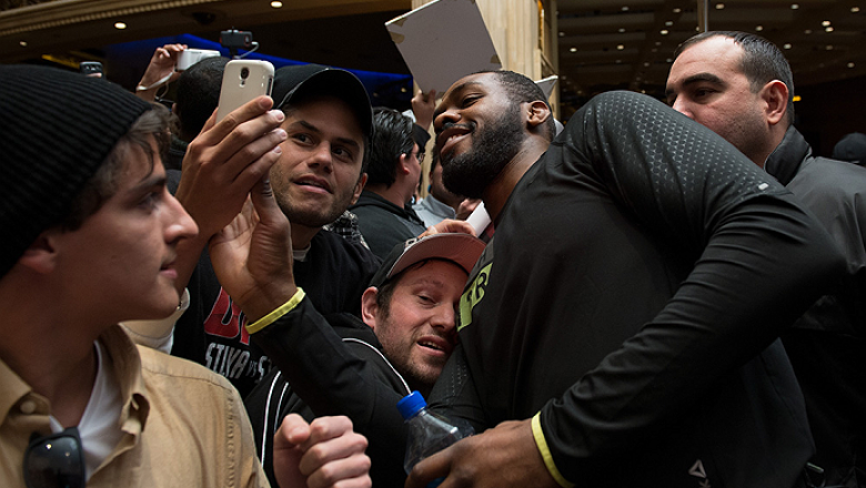 LAS VEGAS, NEVADA - DECEMBER 31:  Jon Jones takes pictures with fans during the UFC 182 Open Workouts at the MGM Grand Hotel and Casino on December 31, 2014 in Las Vegas, Nevada. (Photo by Brandon Magnus/Zuffa LLC/Zuffa LLC via Getty Images)