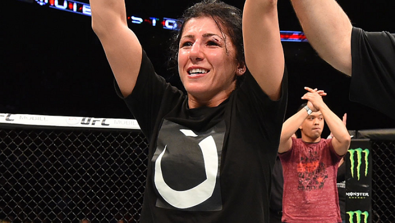 MONTREAL, QC - APRIL 25:   Randa Markos of Canada celebrates her decision victory over Aisling Daly of Ireland in their women's strawweight bout during the UFC 186 event at the Bell Centre on April 25, 2015 in Montreal, Quebec, Canada. (Photo by Josh Hedg