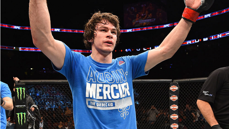 MONTREAL, QC - APRIL 25:   Olivier Aubin-Mercier of Canada reacts after his submission victory over David Michaud of the United States in their lightweight bout during the UFC 186 event at the Bell Centre on April 25, 2015 in Montreal, Quebec, Canada. (Ph