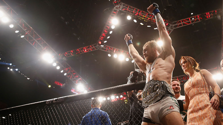 LAS VEGAS, NV - JULY 11:  Conor McGregor  reacts to his victory over Chad Mendes in their UFC interim featherweight title fight during the UFC 189 event inside MGM Grand Garden Arena on July 11, 2015 in Las Vegas, Nevada.  (Photo by Christian Petersen/Zuf