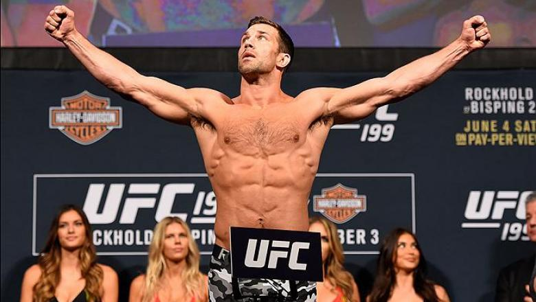INGLEWOOD, CA - JUNE 03:   UFC middleweight champion Luke Rockhold steps on the scale during the UFC 199 weigh-in at the Forum on June 3, 2016 in Inglewood, California. (Photo by Josh Hedges/Zuffa LLC/Zuffa LLC via Getty Images)