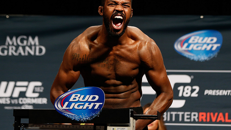 """LAS VEGAS, NV - JANUARY 02:  UFC light heavyweight champion Jon """"Bones"""" Jones poses on the scale after weighing in during the UFC 182 weigh-in event at the MGM Grand Conference Center on January 2, 2015 in Las Vegas, Nevada. (Photo by Josh Hedges/Zuffa LL"""