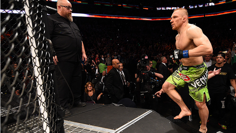 BOSTON, MA - JANUARY 18:  Dennis Siver of Germany enters the Octagon before a featherweight fight against Conor McGregor of Ireland during the UFC Fight Night event at the TD Garden on January 18, 2015 in Boston, Massachusetts. (Photo by Jeff Bottari/Zuff