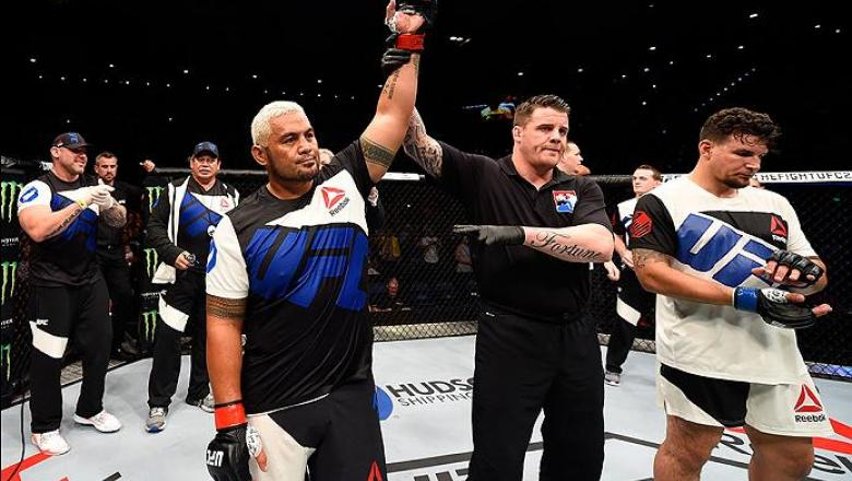 BRISBANE, AUSTRALIA - MARCH 20:  (L-R) Mark Hunt of New Zealand celebrates after defeating Frank Mir of the United States after their heavyweight bout during the UFC Fight Night event at the Brisbane Entertainment Centre on March 20, 2016 in Brisbane, Aus