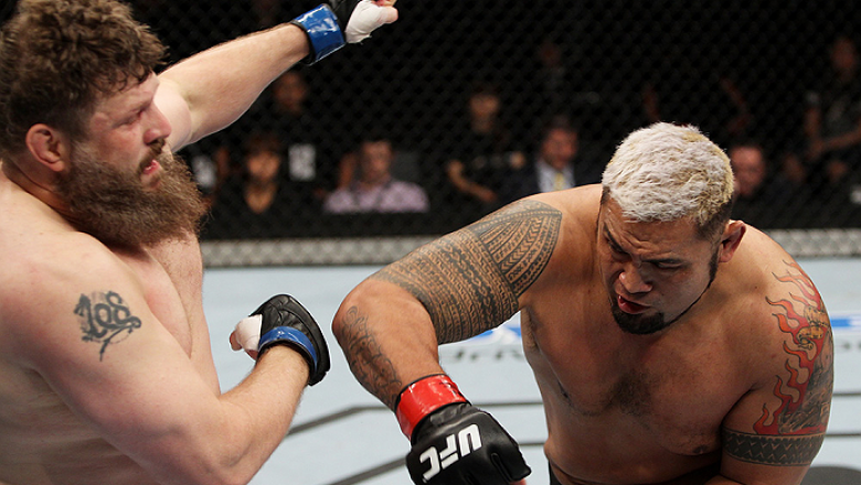 SAITAMA, JAPAN - SEPTEMBER 20:  Mark Hunt throws a punch at Roy Nelson in their heavyweight bout during the UFC Fight Night event inside the Saitama Arena on September 20, 2014 in Saitama, Japan. (Photo by Mitch Viquez/Zuffa LLC/Zuffa LLC via Getty Images