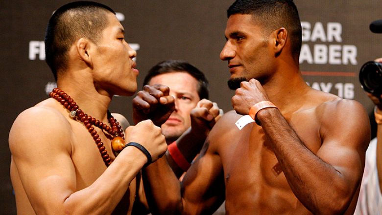 PASAY, METRO MANILA, PHILIPPINES - MAY 15: (L and R) Li Jingliang and Dhiego Lima face-off during the UFC weigh-in event at the Mall of Asia Arena on May 15, 2015 in Pasay, Metro Manila, Philippines. (Photo by Mitch Viquez/Zuffa LLC/Zuffa LLC via Getty Im