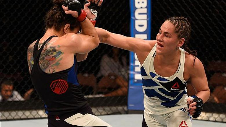 LAS VEGAS, NV - MAY 29:  (R-L) Jessica Eye punches Sara McMann in their women's bantamweight bout during the UFC Fight Night event inside the Mandalay Bay Events Center on May 29, 2016 in Las Vegas, Nevada.  (Photo by Josh Hedges/Zuffa LLC/Zuffa LLC via G