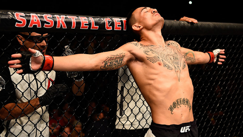 SASKATOON, SK - AUGUST 23:  Max Holloway of the United States stands in the Octagon before his featherweight bout against Charles Oliveira during the UFC event at the SaskTel Centre on August 23, 2015 in Saskatoon, Saskatchewan, Canada. (Photo by Jeff Bot