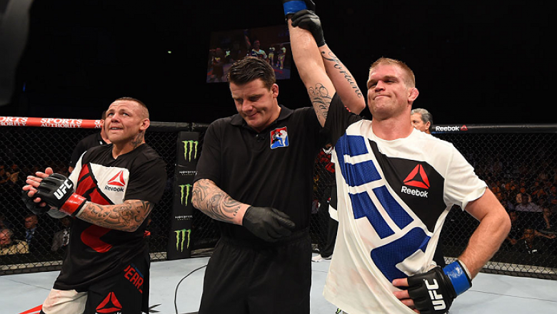 GLASGOW, SCOTLAND - JULY 18:  Evan Dunham of the United States reacts after his unanimous-decision victory over Ross Pearson of England in their lightweight fight during the UFC Fight Night event inside the SSE Hydro on July 18, 2015 in Glasgow, Scotland.