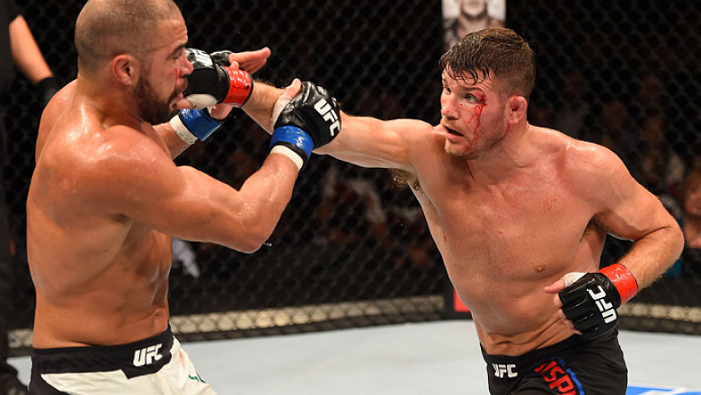 GLASGOW, SCOTLAND - JULY 18:  (R-L) Michael Bisping of England punches Thales Leites in their middleweight fight during the UFC Fight Night event inside the SSE Hydro on July 18, 2015 in Glasgow, Scotland.  (Photo by Josh Hedges/Zuffa LLC/Zuffa LLC via Ge