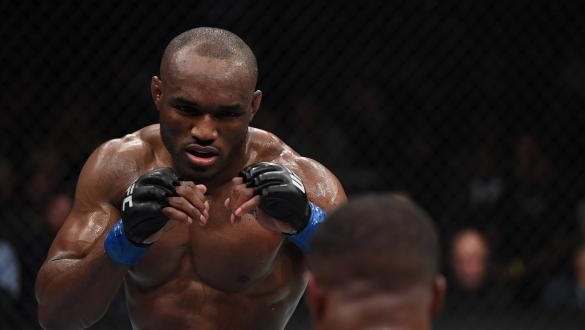 Kamaru Usman of Nigeria faces Tyron Woodley in their UFC welterweight championship bout during the UFC 235 event at T-Mobile Arena on March 2, 2019 in Las Vegas, Nevada. (Photo by Jeff Bottari/Zuffa LLC)