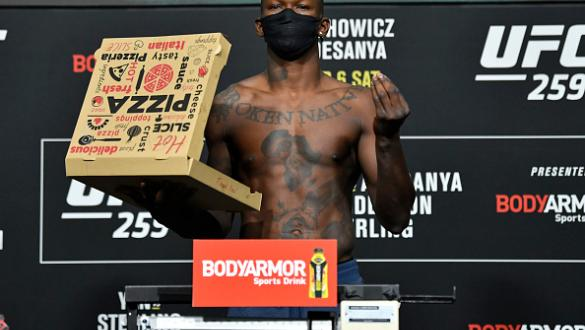 Israel Adesanya of Nigeria poses on the scale during the UFC 259 weigh-in at UFC APEX on March 05, 2021 in Las Vegas, Nevada. (Photo by Jeff Bottari/Zuffa LLC)