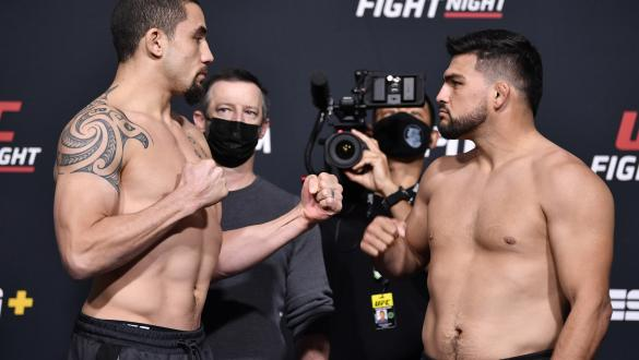 Robert Whittaker of Australia and Kelvin Gastelum face off during the UFC weigh-in at UFC APEX on April 16, 2021 in Las Vegas, Nevada. (Photo by Chris Unger/Zuffa LLC)