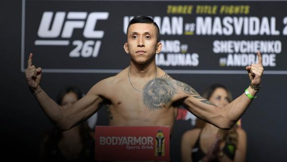 Jeff Molina poses on the scale during the ceremonial UFC 261 weigh-in at VyStar Veterans Memorial Arena on April 23, 2021 in Jacksonville, Florida. (Photo by Josh Hedges/Zuffa LLC)