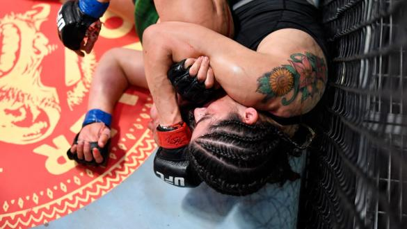 Julia Avila secures a rear choke against Julija Stoliarenko of Lithuania in a bantamweight fight during the UFC Fight Night event at UFC APEX on June 26, 2021 in Las Vegas, Nevada. (Photo by Chris Unger/Zuffa LLC)