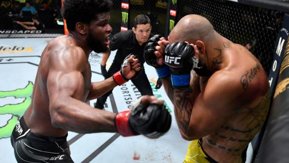 Kennedy Nzechukwu of Nigeria punches Danilo Marques of Brazil in a light heavyweight fight during the UFC Fight Night event at UFC APEX on June 26, 2021 in Las Vegas, Nevada. (Photo by Chris Unger/Zuffa LLC)