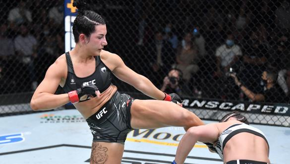 Cheyanne Buys kicks Glorida de Paula in their strawweight bout on July 31 2021 on UFC Fight NIght: Hall vs Strickland