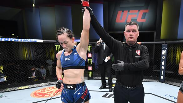Jinh Yu Frey reacts after her victory over Ashley Yoder in a strawweight fight during the UFC Fight Night event at UFC APEX on July 31 2021 in Las Vegas Nevada. (Photo by Chris Unger/Zuffa LLC)