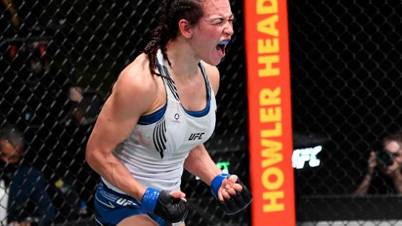 Miesha Tate reacts after her victory over Marion Reneau in their bantamweight bout during the UFC Fight Night event at UFC APEX on July 17, 2021 in Las Vegas, Nevada. (Photo by Jeff Bottari/Zuffa LLC)