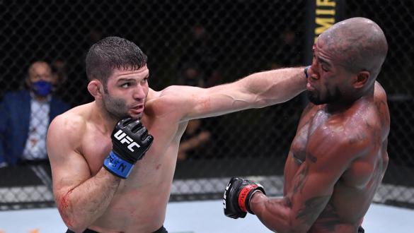Thiago Moises of Brazil punches Bobby Green in a lightweight bout during the UFC Fight Night event at UFC APEX on October 31, 2020 in Las Vegas, Nevada. (Photo by Jeff Bottari/Zuffa LLC)