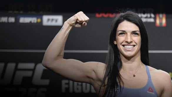 Mackenzie Dern poses on the scale during the UFC 256 weigh-in at UFC APEX on December 11, 2020 in Las Vegas, Nevada. (Photo by Jeff Bottari/Zuffa LLC via Getty Images)