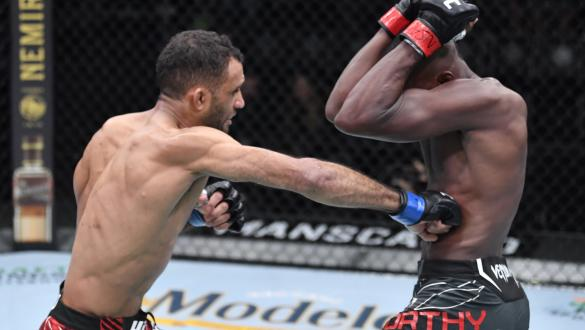 Jai Herbert of England punches Khama Worthy in a lightweight fight during the UFC Fight Night event at UFC APEX on October 23 2021 in Las Vegas Nevada. (Photo by Jeff Bottari/Zuffa LLC)
