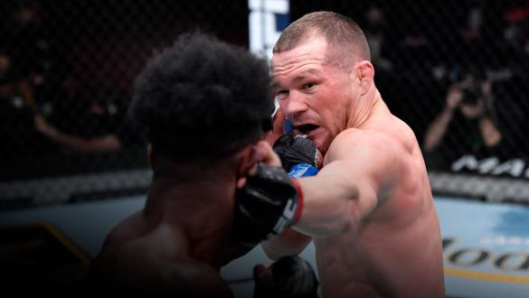 Petr Yan of Russia punches Aljamain Sterling in their UFC bantamweight championship fight during the UFC 259 event at UFC APEX on March 06, 2021 in Las Vegas, Nevada. (Photo by Jeff Bottari/Zuffa LLC)