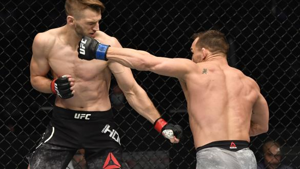 Michael Chandler punches Dan Hooker of New Zealand