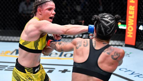 Ariane Carnelossi of Brazil punches Istela Nunes of Brazil in a strawweight fight during the UFC Fight Night event at UFC APEX on October 16 2021 in Las Vegas Nevada. (Photo by Chris Unger/Zuffa LLC)