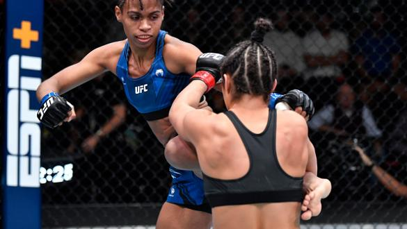 Luana Carolina of Brazil kicks Loopy Godinez of Mexico in a flyweight fight during the UFC Fight Night event at UFC APEX on October 16 2021 in Las Vegas Nevada. (Photo by Chris Unger/Zuffa LLC)