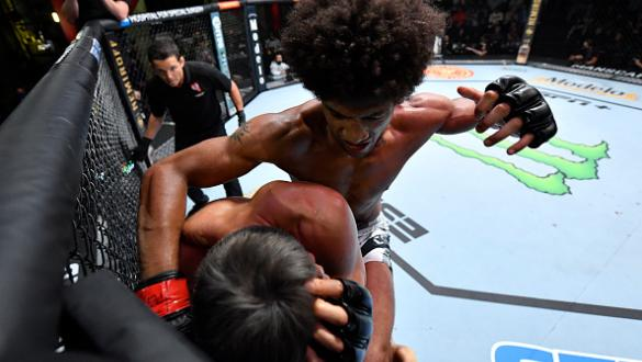 Alex Caceres elbows Seungwoo Choi of South Korea in a featherweight fight during the UFC Fight Night event at UFC APEX on October 23, 2021 in Las Vegas, Nevada. (Photo by Jeff Bottari/Zuffa LLC)