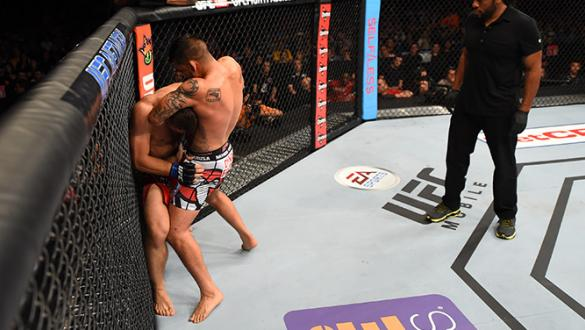 MEXICO CITY, MEXICO - JUNE 13: (R-L) Efrain Escudero of Mexico attempts to submit Drew Dober of the United States in their lightweight bout during the UFC 188 event at the Arena Ciudad de Mexico on June 13, 2015 in Mexico City, Mexico. (Photo by Josh Hedg