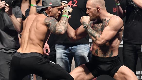 Dustin Poirier and Conor McGregor face off