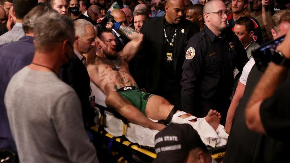 LAS VEGAS, NEVADA - JULY 10: Conor McGregor of Ireland is carried out of the arena on a stretcher after injuring his ankle in the first round of his lightweight bout against Dustin Poirier during UFC 264