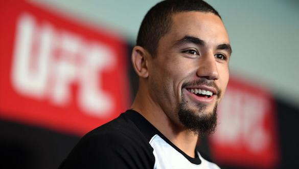 MELBOURNE, AUSTRALIA - NOVEMBER 25:  Robert Whittaker of New Zealand interacts with the media during the UFC Fight Night Ultimate Media Day at the Melbourne Convention and Exhibition Centre on November 25, 2016 in Melbourne, Australia. (Photo by Jeff Bott