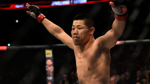 SHANGHAI, CHINA - NOVEMBER 25:  Li Jingliang of China celebrates after his knockout victory over Zak Ottow in their welterweight bout during the UFC Fight Night event inside the Mercedes-Benz Arena on November 25, 2017 in Shanghai, China. (Photo by Brando