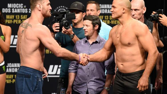 DALLAS, TX - MAY 12:  (L-R) UFC heavyweight champion Stipe Miocic and Junior Dos Santos of Brazil shake hands during the UFC 211 weigh-in at the American Airlines Center on May 12, 2017 in Dallas, Texas. (Photo by Josh Hedges/Zuffa LLC/Zuffa LLC via Getty