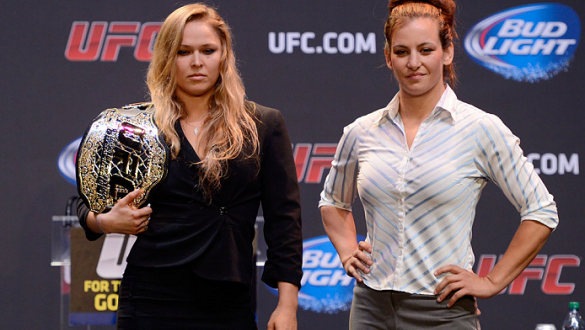 LOS ANGELES, CA - JULY 30:  UFC women's bantamweight champion Ronda Rousey (L) and Miesha Tate face off during the UFC World Tour 2013 at Club Nokia at L.A. Live on July 30, 2013 in Los Angeles, California. Ronda Rousey will defend the UFC women's bantamw