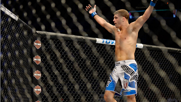 MILWAUKEE, WI - AUGUST 31:  Al Iaquinta celebrates after round one between Ryan Couture (not pictured) in their UFC lightweight bout at BMO Harris Bradley Center on August 31, 2013 in Milwaukee, Wisconsin. (Photo by Jeff Bottari/Zuffa LLC/Zuffa LLC via Ge