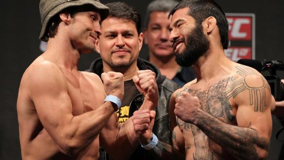 STOCKHOLM, SWEDEN - APRIL 13:  (L-R) Bantamweight opponents Brad Pickett and Damacio Page face off after weighing in during the official UFC on Fuel TV weigh in event at Ericsson Globe on April 13, 2012 in Stockholm, Sweden.  (Photo by Josh Hedges/Zuffa L