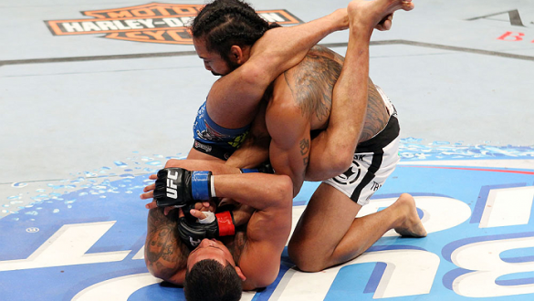 MILWAUKEE, WI - AUGUST 31:  (L-R) Anthony Pettis puts Benson Henderson in an armbar in their UFC lightweight championship bout at BMO Harris Bradley Center on August 31, 2013 in Milwaukee, Wisconsin. (Photo by Ed Mulholland/Zuffa LLC/Zuffa LLC via Getty I