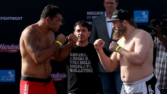ABU DHABI, UNITED ARAB EMIRATES - APRIL 10:  Antonio Rodrigo Nogueira and Roy Nelson face-off after they weigh-in for UFC Fight Night 39 on April 10, 2014 in Abu Dhabi, United Arab Emirates. UFC Fight Night 39 will take place on April 11 at du Arena featu