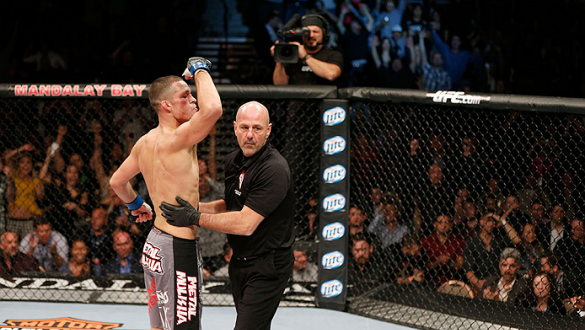 LAS VEGAS, NV - NOVEMBER 30:  (L-R) Nate Diaz is called off by referee Yves Lavigne after knocking out Gray Maynard in their lightweight fight during The Ultimate Fighter season 18 live finale inside the Mandalay Bay Events Center on November 30, 2013 in