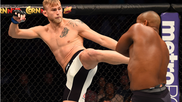 HOUSTON, TX - OCTOBER 03:  (L-R) Alexander Gustafsson kicks Daniel Cormier in their UFC light heavyweight championship bout during the UFC 192 event at the Toyota Center on October 3, 2015 in Houston, Texas. (Photo by Josh Hedges/Zuffa LLC/Zuffa LLC via G