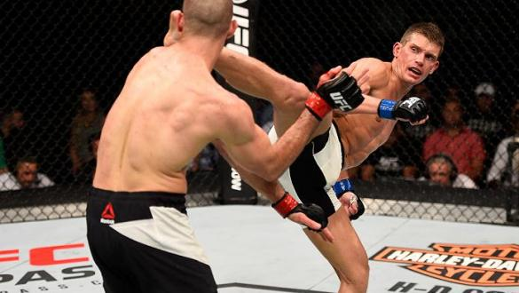OTTAWA, ON - JUNE 18:   (R-L) Stephen Thompson of the United States kicks Rory MacDonald of Canada in their welterweight bout during the UFC Fight Night event inside the TD Place Arena on June 18, 2016 in Ottawa, Ontario, Canada. (Photo by Jeff Bottari/Zu