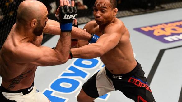 TAMPA, FL - APRIL 16:   (R-L) John Dodson punches Manny Gamburyan in their flyweight bout during the UFC Fight Night event at Amalie Arena on April 16, 2016 in Tampa, Florida. (Photo by Jeff Bottari/Zuffa LLC/Zuffa LLC via Getty Images)