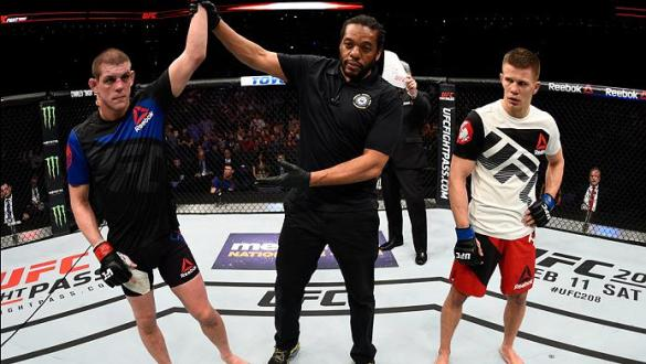 PHOENIX, AZ - JANUARY 15:  (L-R) Joe Lauzon celebrates his victory over Marcin Held of Poland in their lightweight bout during the UFC Fight Night event inside Talking Stick Resort Arena on January 15, 2017 in Phoenix, Arizona. (Photo by Jeff Bottari/Zuff